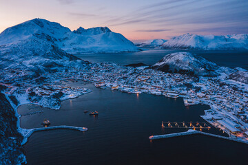 Wall Murals City on the water Aerial view of the nordic seaside town in winter at sunset