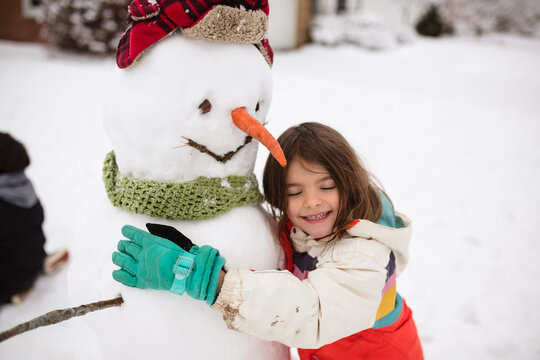 snowman with hat, scarf, gloves and carrot nose