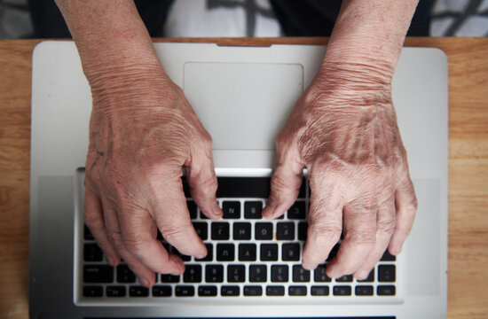Elderly Man in a Retirement Home Using Computer