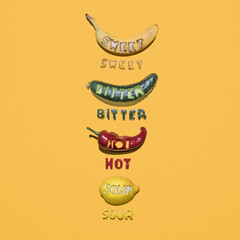 colorful foods with cut-out letters that indicate their taste on the yellow background