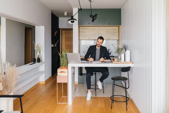 Young interior designer working from home