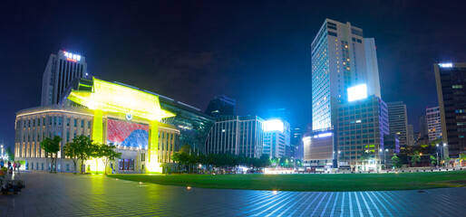 Cityhall building with recreational plaza and business buildings near it - Seoul, South Korea