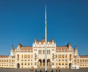 BUDAPEST, HUNGARY - JUNE 16, 2016: Hungarian National Parliament building in Budapest with huge flagpole near it's left side entrance, Hungary
