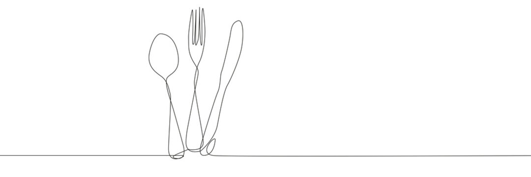 Fork spoon and knifeon white background