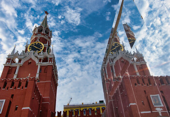 Moscow, Russian Fedration/ September 8, 2020; The Kremlin's Spasskaya Tower and its reflection in the mirror wall