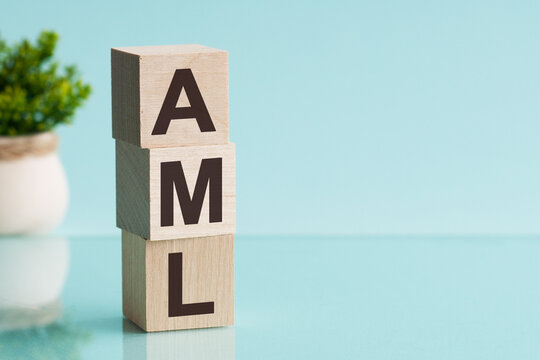 AML - Anti-Money Laundering - acronym on wooden cubes