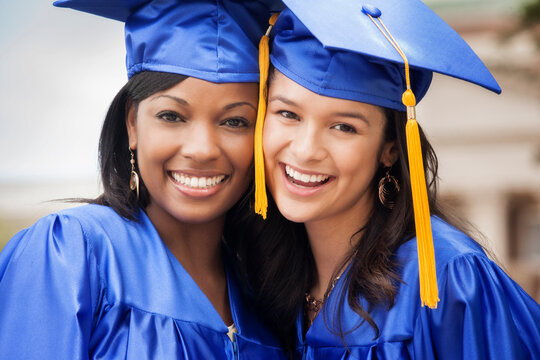 College graduates smiling together