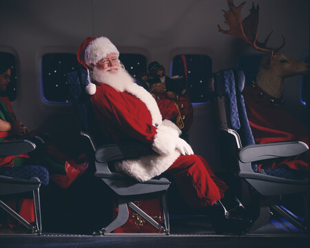 Santa Claus, elves, reindeer and presents on an airplane
