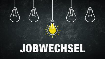 Jobwechsel. Text auf einer schwarzen Tafel mit Glühbirnen.