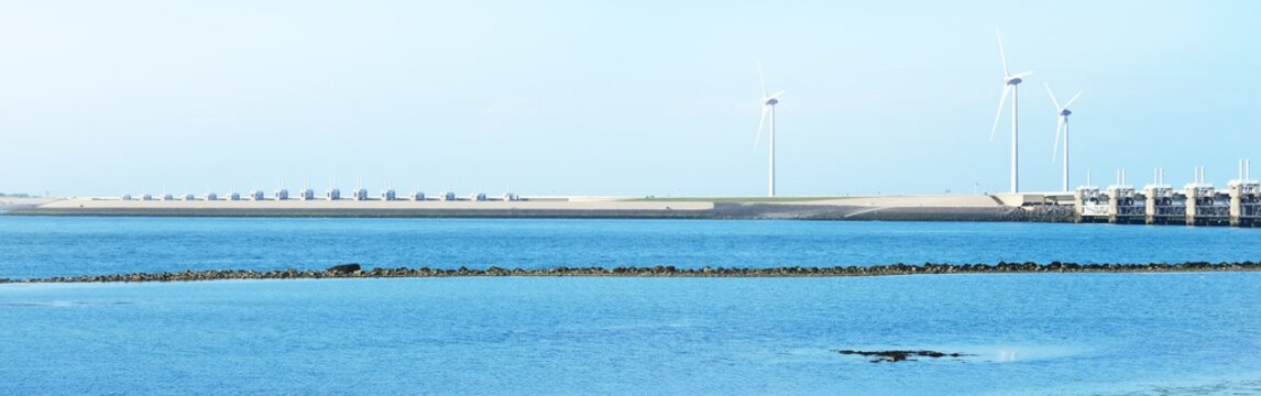 Neeltje Jans dam in Zeeland, Netherlands. Wind turbine generators in the background. Panoramic view. Environmental damage and conservation, alternative energy, power in nature, ecological issues