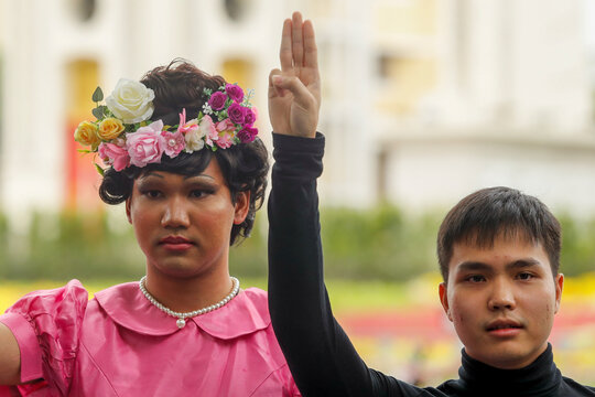 Tattep Ruangprapaikit, leader of the Free People group, makes a three-fingers salute during a news conference in Bangkok