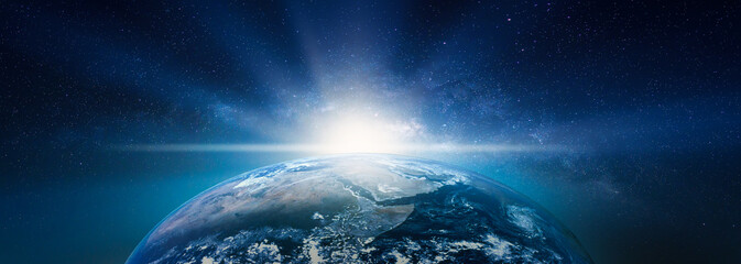 Wall Mural - Landscape with Milky way galaxy. Sunrise and Earth view from space with Milky way galaxy. (Elements of this image furnished by NASA)