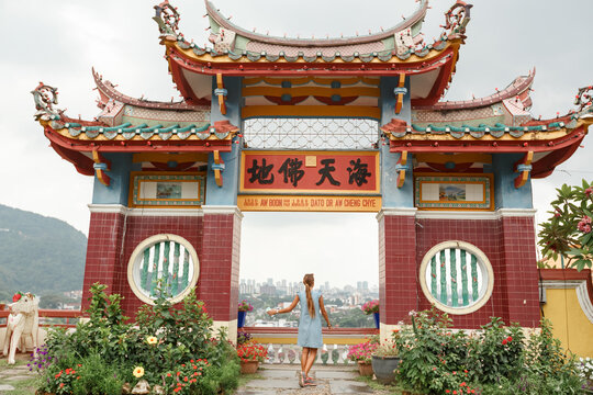 Back view young tourist woman at the Chinese temple in Penang, Malaysia, Kek Lok Si