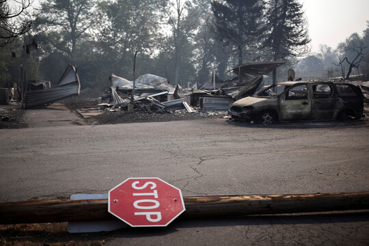 A stop sign is seen at a neighborhood destroyed by wildfires near Bear Creek, Phoenix, Oregon