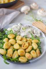 home made gnocchi with mushrooms and arugula salad