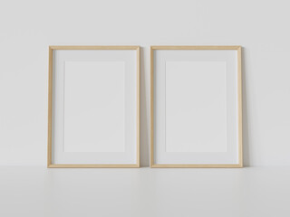 Two wooden frames leaning on white floor in interior mockup. Template of pictures framed on a wall 3D rendering