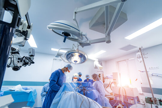 Modern equipment in operating room. Medical devices for neurosurgery. Operation in the background. Operating theatre. Selective focus.