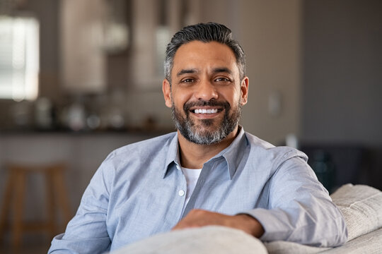 Portrait of happy indian man smiling at home