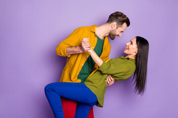 Profile side view portrait of his he her she nice attractive cheerful cheery glad couple embracing...