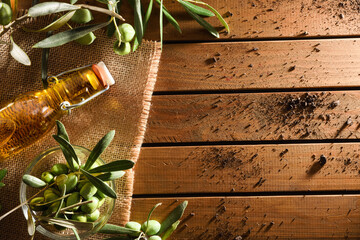 Olive oil and olives on wood table top