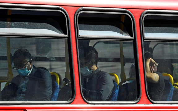 "Passengers wear protective face coverings on a London bus, whilst the reproduction ""R"" number of COVID-19 infections in the United Kingdom has risen and may be above 1, London, Britain"