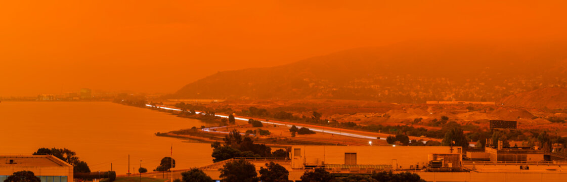 Orange haze over San Francisco on September 9 2020 from record wildfires in Californa, ash and smoke in the sky, daytime