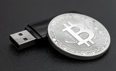 Coin of bitcoin with flash drive on black background.