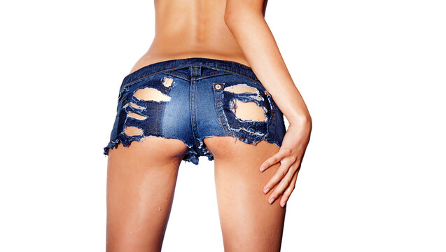 Rear view of woman wearing sexy denim short shorts with holes.