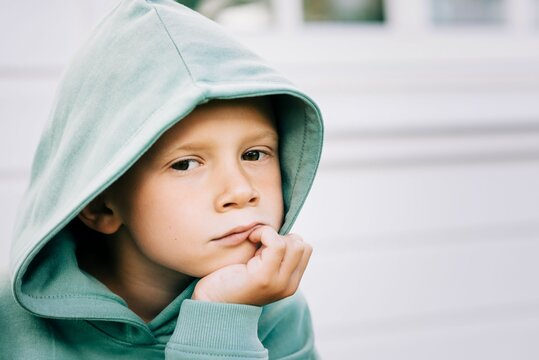 close up portrait of a boy with his hood up