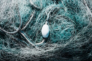Fishermans nets and buoy tangled together