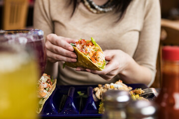 Cinco: Anonymous Woman Holding Shrimp Taco In Fried Shell