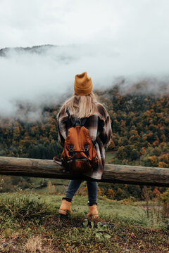 woman traveling and exploring nature on an autumn day.
