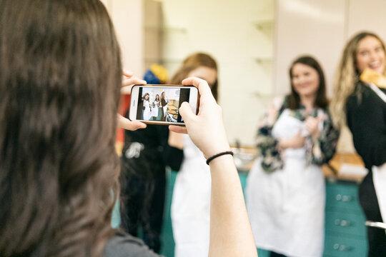 Class: Women Having Fun Taking Cell Phone Photos