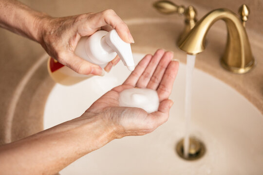 Woman Washing Hands With Foaming Soap Sanitizer