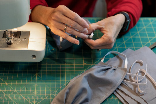 Woman Sewing Homemade Medical Masks During Virus Shortage