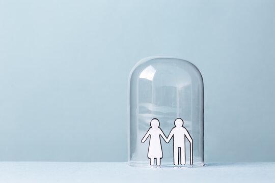 Elderly couple in a glass bubble