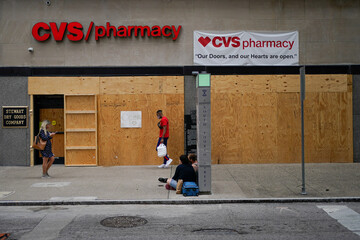 Businesses are boarded up in anticipation of protests in Louisville