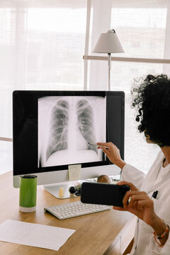 Telemedicine - Doctor Explaining Lung X-Ray