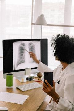 Telemedicine - Doctor Explaining Lung X-Ray Via Video