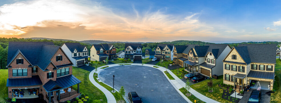Aerial sunset panoramic view of newly built high end luxury single family alp style house community at Lake Linganore Oakdale surrounding a cul-de-sac neighborhood street in Maryland USA