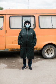 Senior woman wearing disposable mask on the street