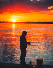 silhouette of a person at sunset  man fishing