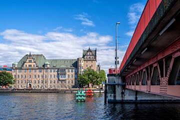Red metallic bridge (Dlugi bridge or Long bridge) across the Oder river and Customs Chamber, Szczecin, Poland