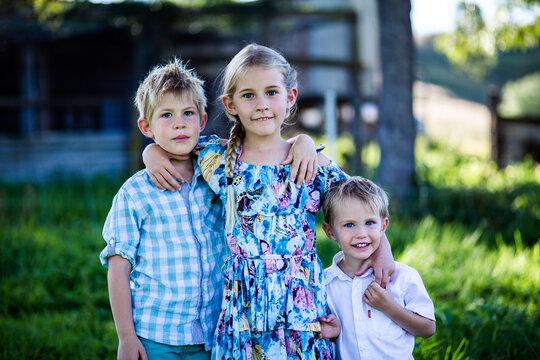 Portrait of siblings standing outdoors