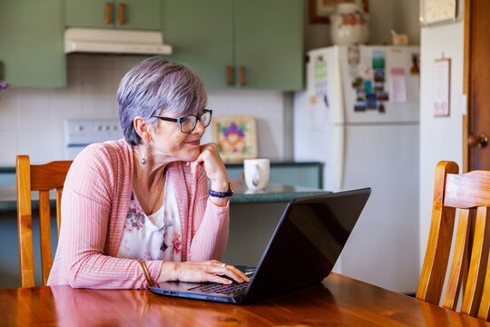 Middle aged woman using online banking from her laptop
