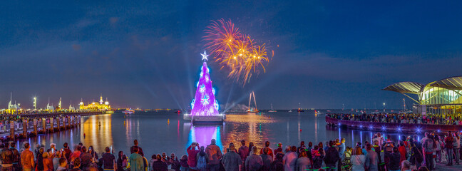 New Years fireworks over a floating Christmas Tree along the waterfront
