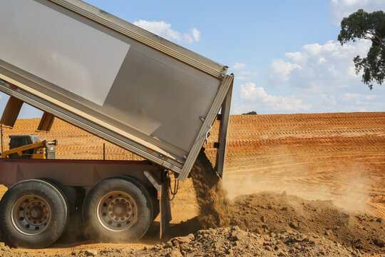 truck tipping soil on a construction site