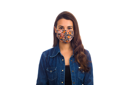 Beautiful young woman wearing a protective mask isolated on a white background