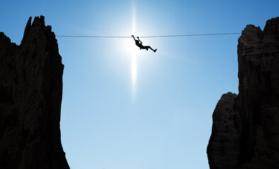 Man balancing on the rope concept of challenge and risk taking