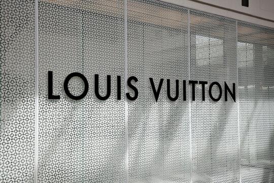 Honolulu, Hawaii, U.S.A. - LOUIS VUITTON: Company logo typography of Louis Vuitton in Ala Moana Center